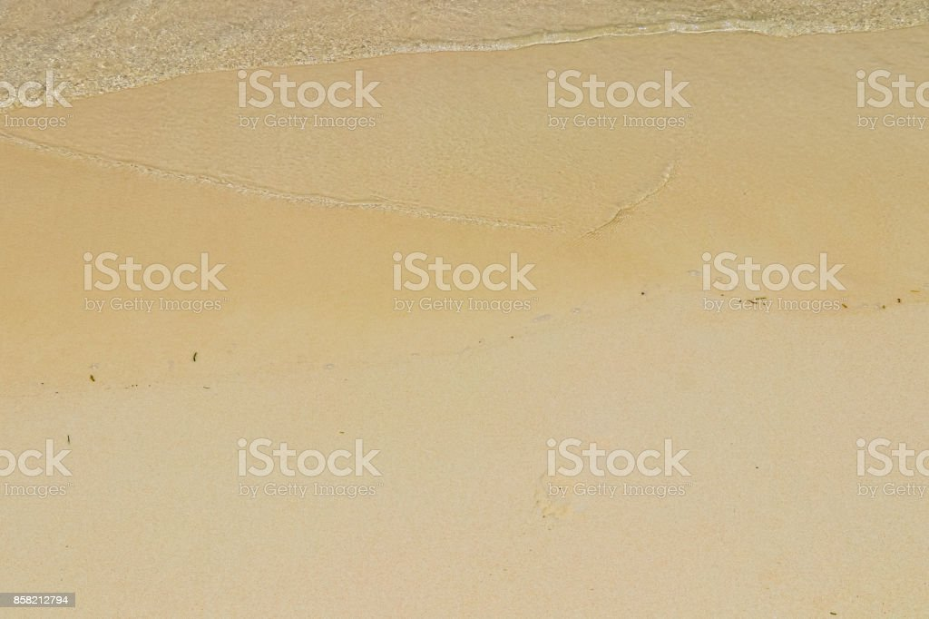Ocean, waves, beach and sand. Natural textures of the surface of water and sand. The coast of Indian Ocean. Seychelles stock photo
