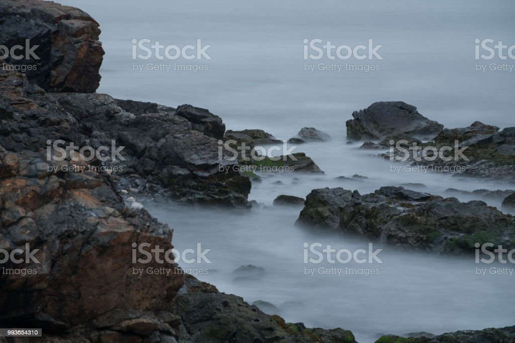 Ocean Waves Over Rocks stock photo