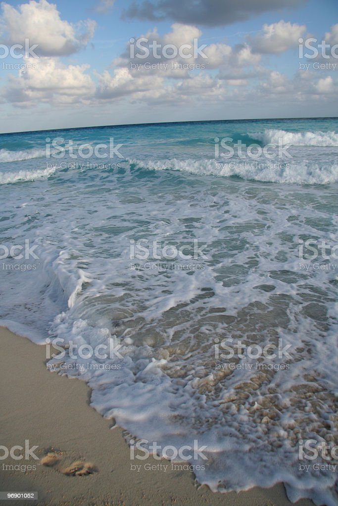 Ocean Waves with Foot Print in Sand royalty-free stock photo
