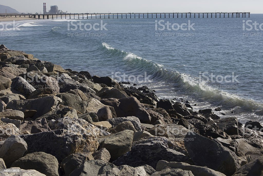Ocean with Pier and Power Plant stock photo