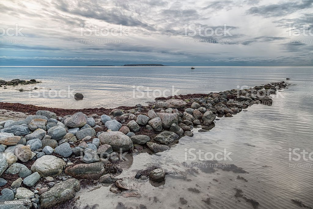 Ocean with Rocks and Clouds stock photo