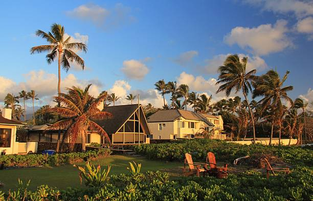 oceanfront home on oahu hawaii at sunset - hawaii home stock photos and pictures