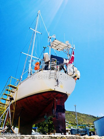 Sailing boat on the hard, undergoing maintenance.
