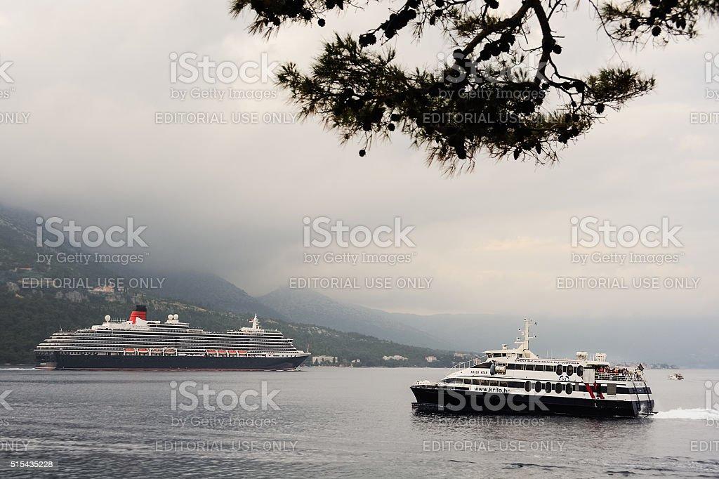 Oceanliner Queen Elisabeth II passing Korcula stock photo