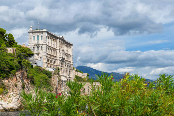 Oceanographic Museum of Monaco Monaco - 02.09.2018: Oceanographic Museum of Monaco seen from Fontvieille with green plants and space for text ville stock pictures, royalty-free photos & images
