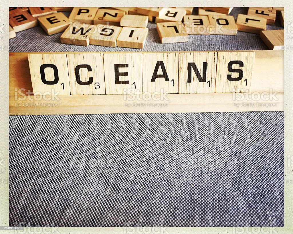 Oceans Spelled with Scrabble Tiles stock photo