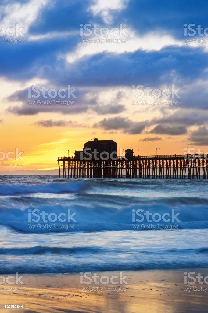 Oceanside California Boardwalk and beach shoreline stock photo