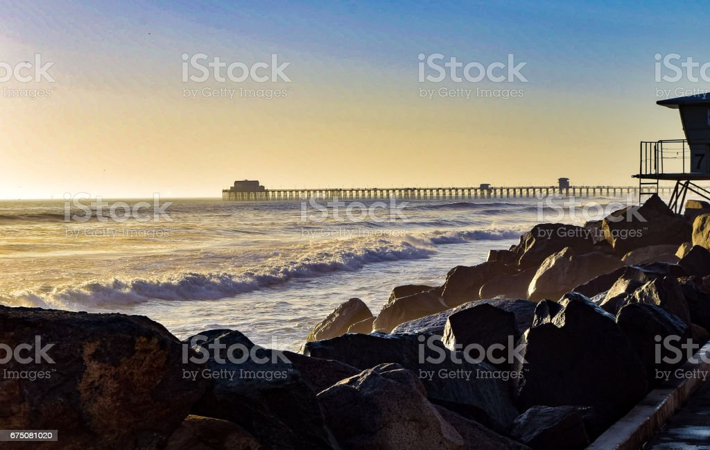 Oceanside Pier and Lifeguard Stand stock photo