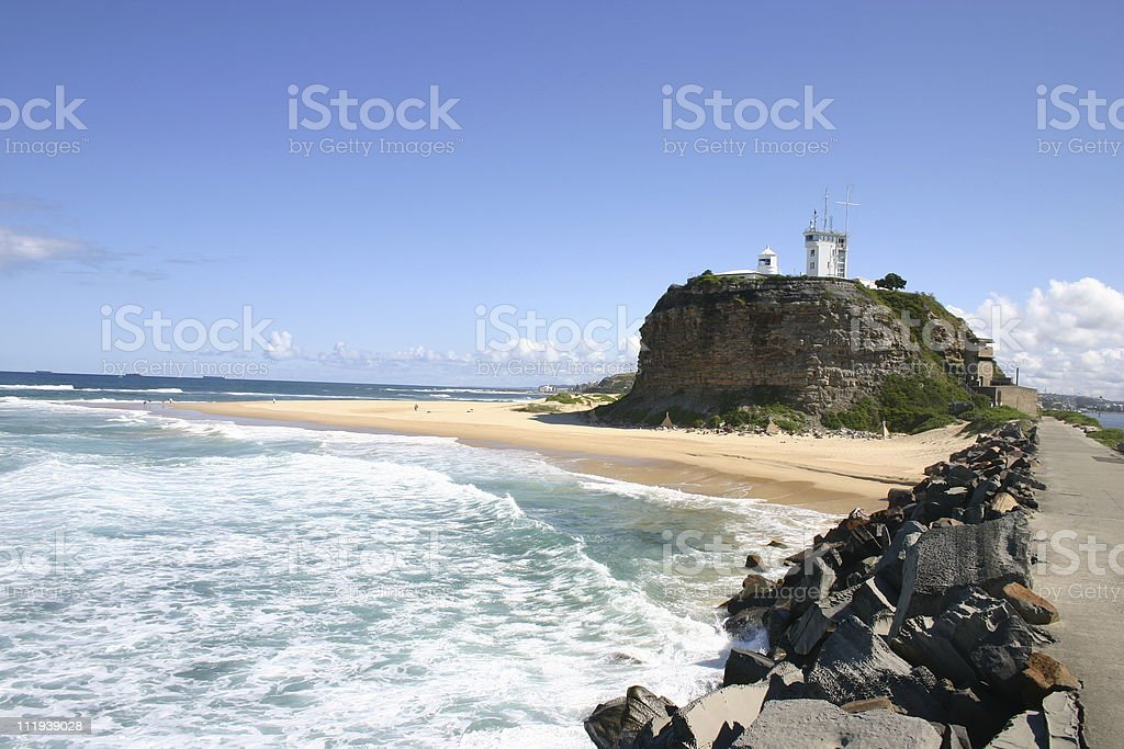 Ocean-side view of Nobbys Head Light in Newcastle, Australia stock photo