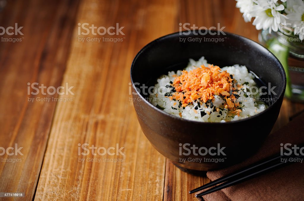 Ochazuke And Flowers On Table stock photo