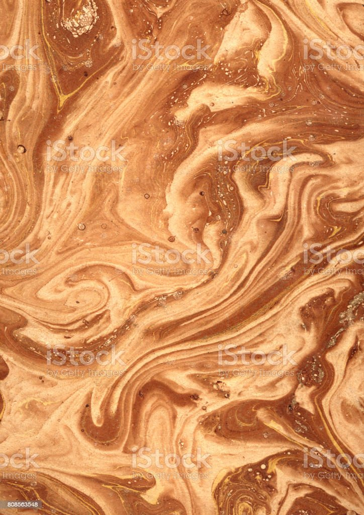 Ocher coloured Victorian Marbled Paper, 19th Century stock photo