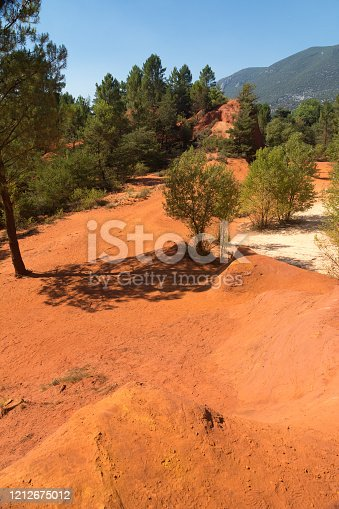 view of the famous Ocra color quarries near Roussillon in France during a sunny day
