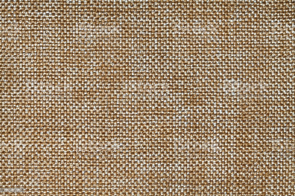 Ocher textile background closeup. Structure of the fabric macro royalty-free stock photo