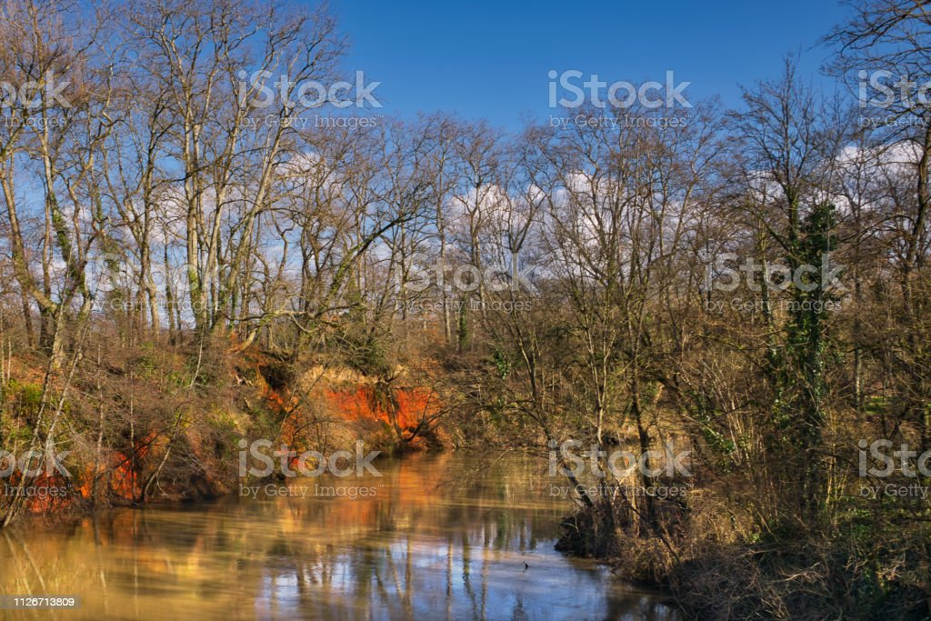 Ochre river bank stock photo