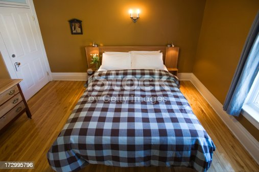 Comfortable bedroom in a charming inn. Indoor photography.