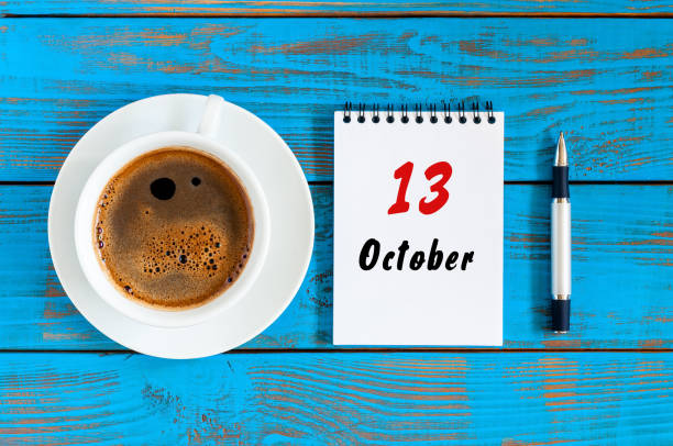October 13th. Day 13 of october month, calendar on workbook with coffee cup at student workplace background. Autumn time October 13th. Day 13 of october month, calendar on workbook with coffee cup at student workplace background. Autumn time. day 4 stock pictures, royalty-free photos & images