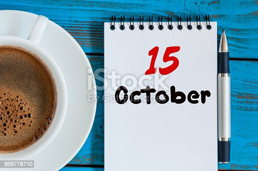 868951648 istock photo October 15th. Day 15 of month, hot coffee cup with calendar on accauntant workplace background. Autumn time. Empty space for text 859778710