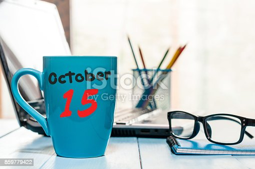 868951648 istock photo October 15th. Day 15 of month, hot coffee cup with calendar on accauntant workplace background. Autumn time. Empty space for text 859779422