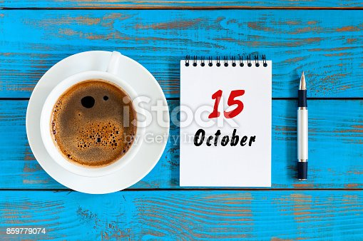 868951648 istock photo October 15th. Day 15 of october month, calendar on workbook with coffee cup at student workplace background. Autumn time 859779074
