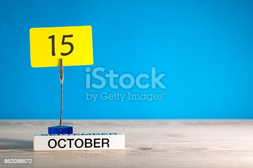 868951648 istock photo October 15th. Day 15 of october month, calendar on workplace with blue background. Autumn time. Empty space for text 852099572