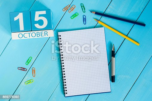 868951648 istock photo October 15th. Image of October 15 wooden color calendar on blue background. Autumn day. Empty space for text 859778392
