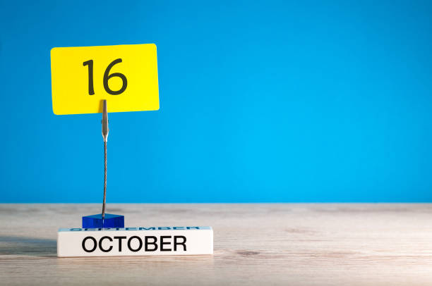 october 16th. day 16 of october month, calendar on workplace with blue background. autumn time. empty space for text - number 16 stock photos and pictures