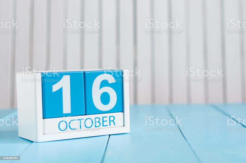 October 16th. Image of October 16 wooden color calendar on white background. Autumn day. Empty space for text stock photo