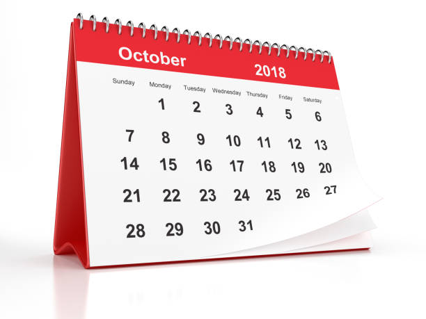 October 2018 Red Plastic Framed Desktop Calendar on White Background stock photo