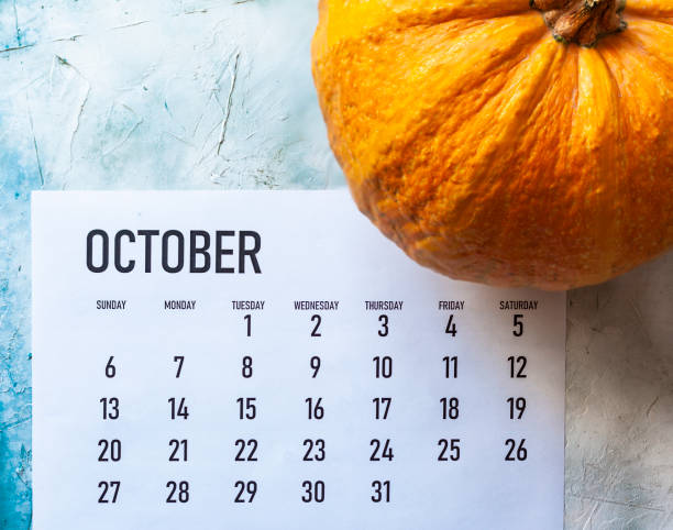 October 2019 calendar with Pumpkin Simple 2019 October monthly calendar on table with a pumpkin october stock pictures, royalty-free photos & images