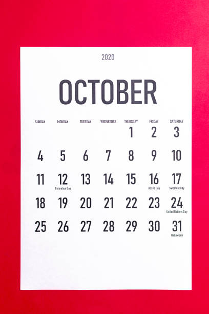 October 2020 calendar with holidays October 2020 calendar with holidays on red paper background boss's day stock pictures, royalty-free photos & images
