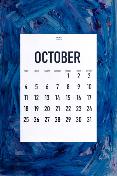 October 2020 simple calendar on trendy classic blue color October 2020 simple calendar on painted background with trendy Classic Blue color boss's day stock pictures, royalty-free photos & images