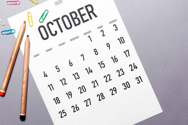 October 2020 simple calendar October 2020 simple calendar with office supplies and copy space boss's day stock pictures, royalty-free photos & images