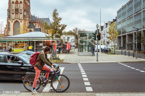 October 25, 2018 Germany is the city of Dusseldorf. Bicycle as an ecological transport, means movement in Europe. A city dweller rides a bike on the way.