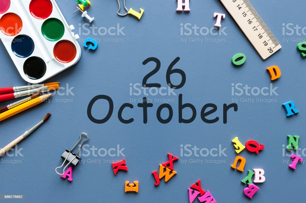 October 26th. Day 26 of october month, calendar on teacher or student table, blue background . Autumn time stock photo