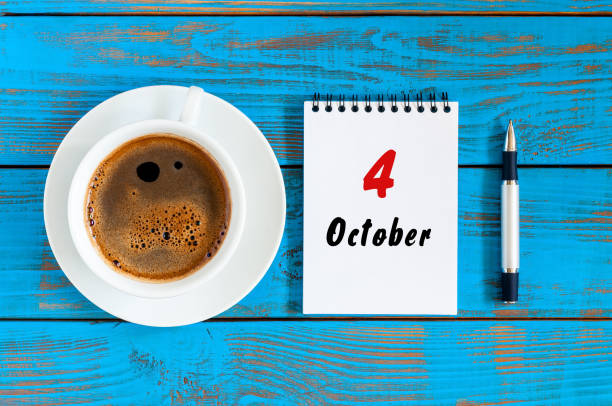 October 4th. Day 4 of october month, calendar on workbook with coffee cup at student workplace background. Autumn time October 4th. Day 4 of october month, calendar on workbook with coffee cup at student workplace background. Autumn time. day 4 stock pictures, royalty-free photos & images