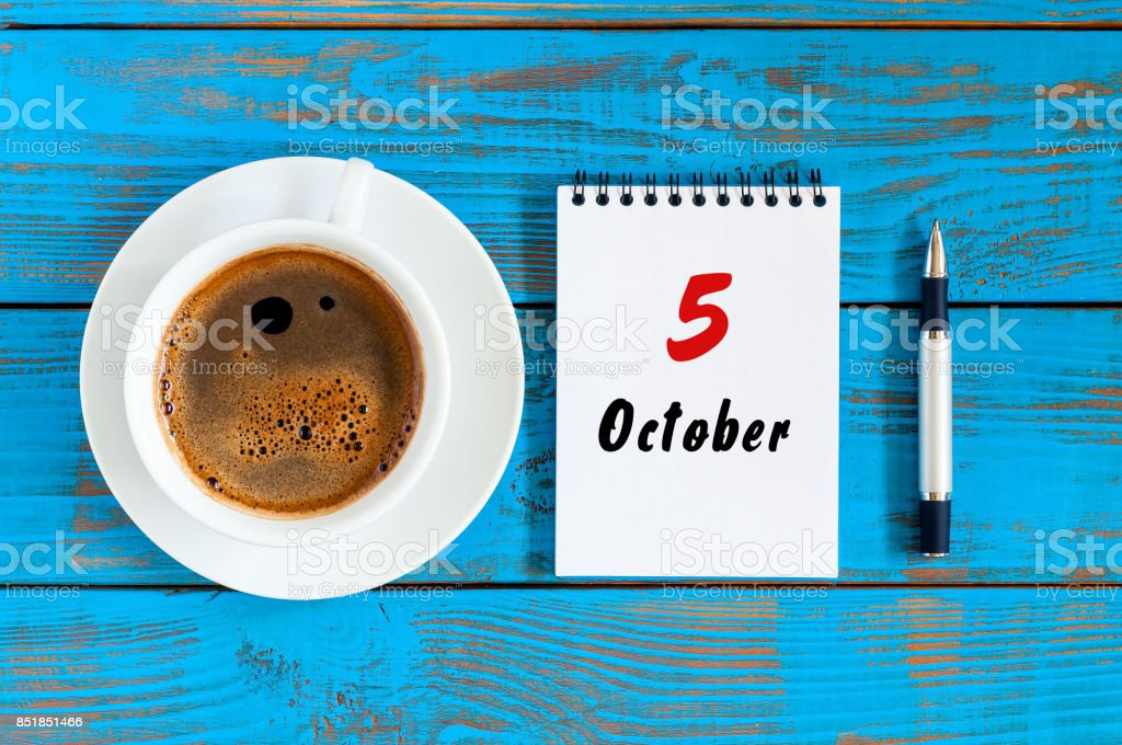 October 5th. Day 5 of october month, calendar on workbook with coffee cup at student workplace background. Autumn time stock photo