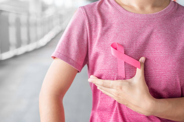 october breast cancer awareness month, woman in pink t- shirt with pink ribbon for supporting people living and illness. healthcare, international women day and world cancer day concept - różowy zdjęcia i obrazy z banku zdjęć