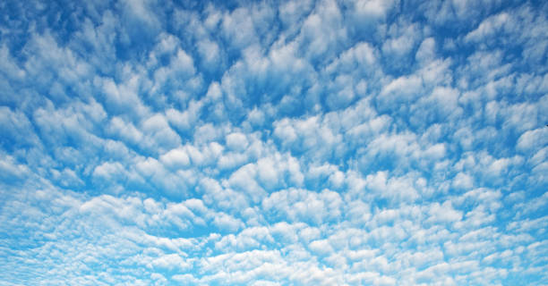 October Sky Cloudscape with Small Altocumulus Clouds October, autumn, blue sky filled with small altocumulus clouds. altocumulus stock pictures, royalty-free photos & images