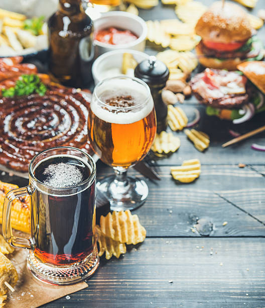 Octoberfest beer and snacks set on dark scorched wooden background stock photo