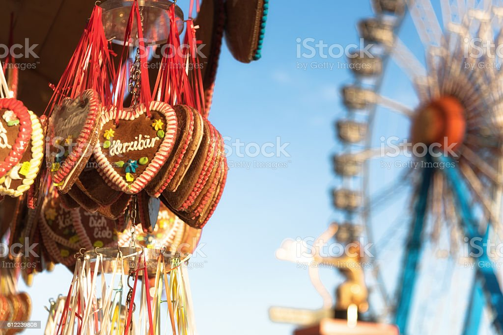 octoberfest gingerbread hearts hanging in front of ferris wheel - Photo
