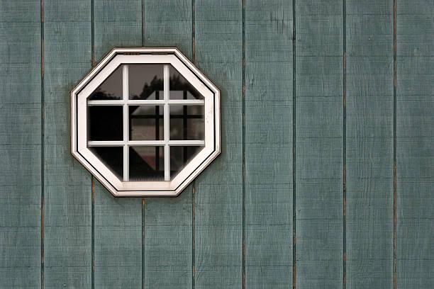 Octogan Window on Green Wall stock photo