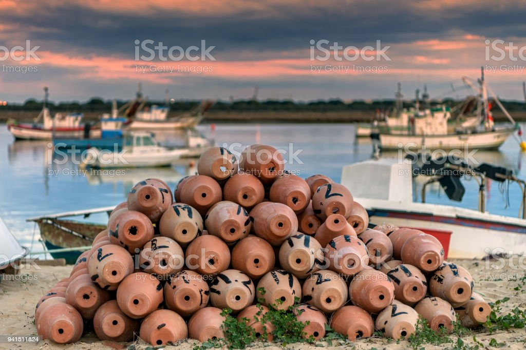 Octopus and squid traps in the fishing village of Puerto Umbria, Southern Spain, at sunset. stock photo