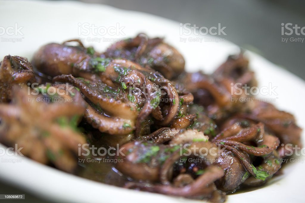 Octopus in Red Wine royalty-free stock photo
