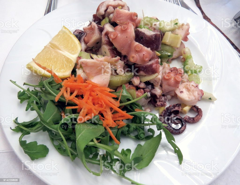 Octopus salad with lettuce and carrots stock photo