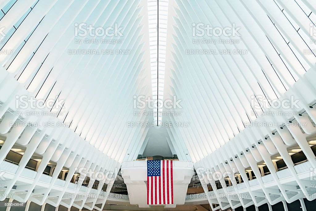 Oculus New York City WTC Transportation Hub New York City, USA - May 7, 2016: American Flag inside the main hall of the new Oculus, the  World Trade Center Transportation Hub: The World Trade Center Transportation Hub is the Port Authority of New York and New Jersey's name for the new PATH.  Lower Manhattan, New York City, USA. Abstract Stock Photo