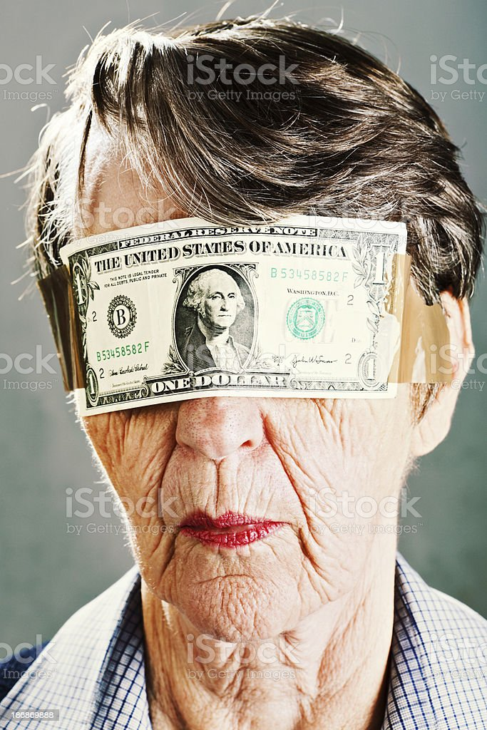 Od woman passively accepts US dollar bill blindfold stock photo