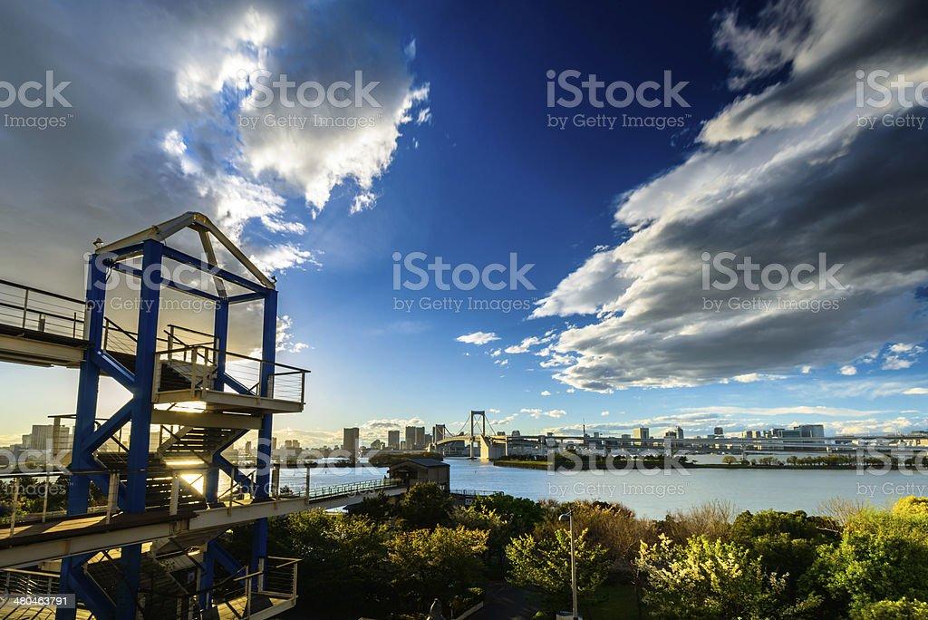 Odaiba rainbow bridge and sunset stock photo