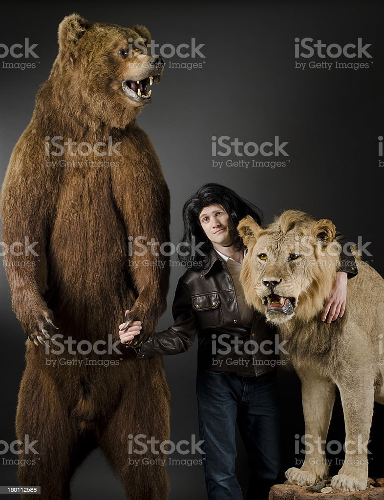 Odd Friends: Grizzly, Man and Lion stock photo