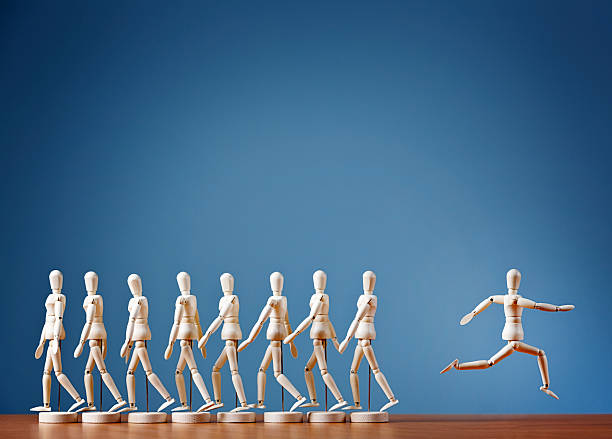 Odd man out rebels, breaking away from the crowd joyously stock photo