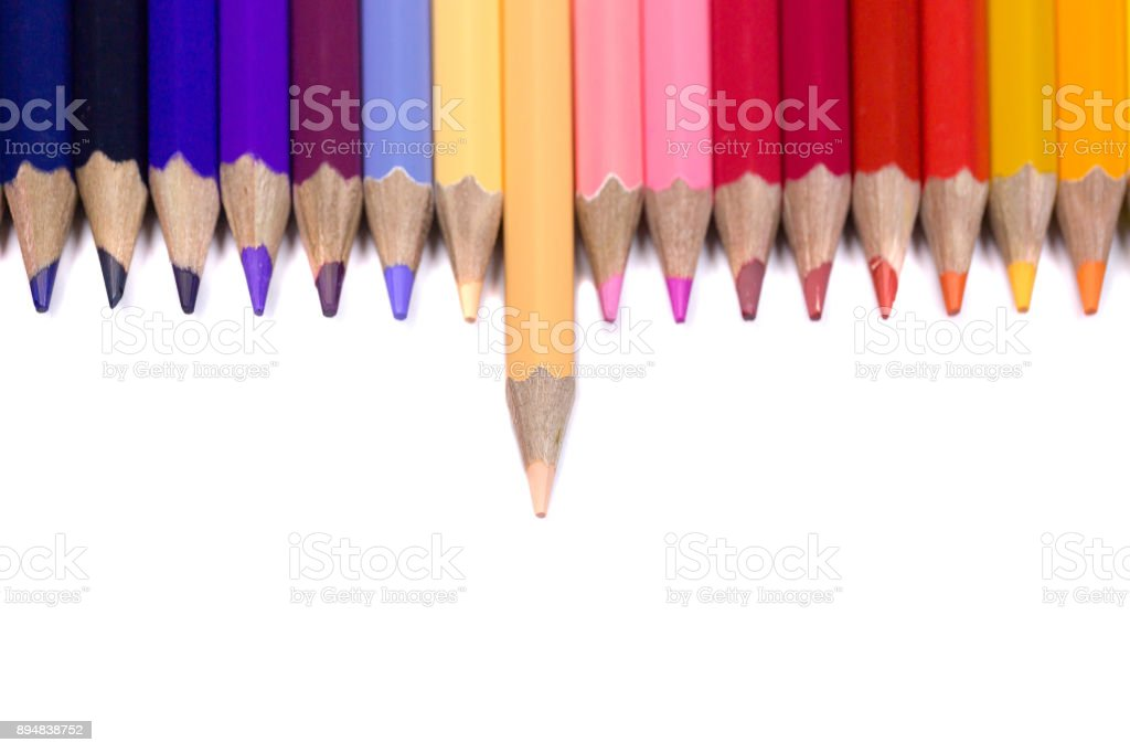 Odd One Out Color Pencil Facing Down on Pure White Background stock photo